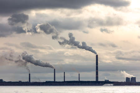 Smoke from the chimneys at the factory. Banco de Imagens - 167321836