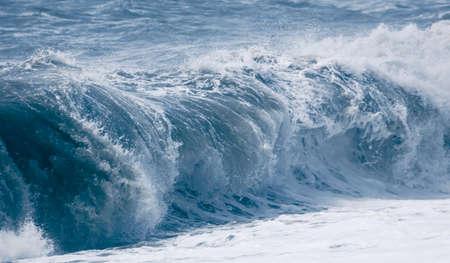 Splashing big waves on the seashore. Storm Banco de Imagens - 167321804