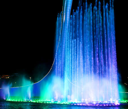 Dancing fountain of green in the park. Splashing water