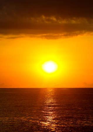 Horizon of sea and sky water as background. Golden sunset Banco de Imagens - 167322244