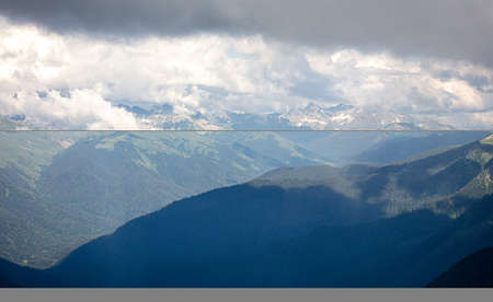 Caucasus mountains in the clouds in summer. Nature Banco de Imagens