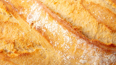 Fresh bread crust as background. Close-up Banco de Imagens - 167321854