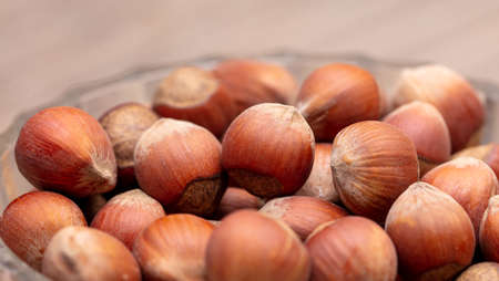 Close-up of fresh hazelnuts as background. Macro Banco de Imagens - 167320824