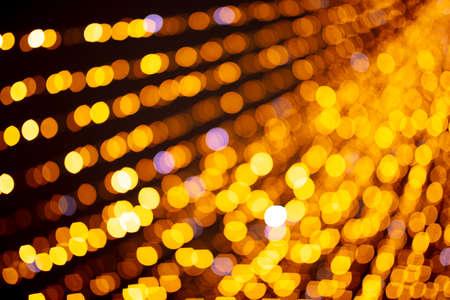 Festive golden bokeh as abstract background. Banco de Imagens