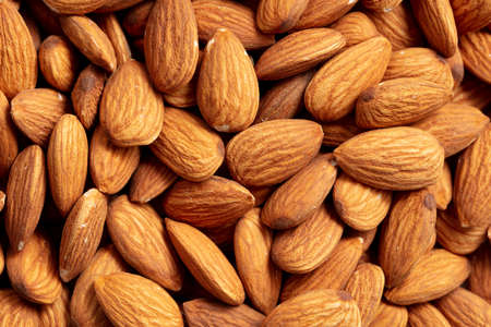 Close up of almond nuts as background. Macro