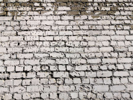 Old crumbling brick wall as an abstract background.