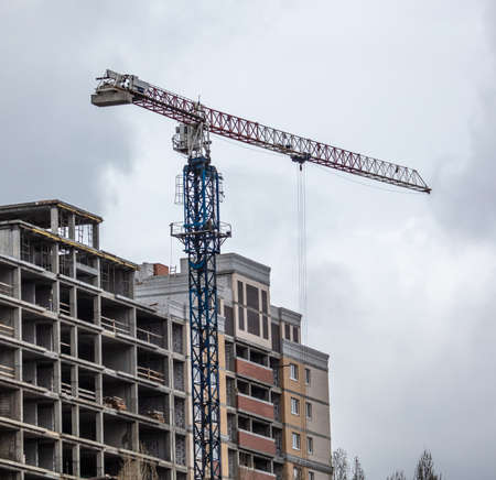 Tower crane at the construction site of a multi-storey building. Banco de Imagens