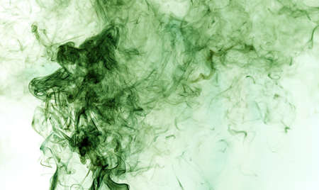 Green smoke on a white background. Abstraction