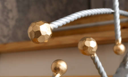 Gold-plated metal balls as decoration in the house. Banco de Imagens