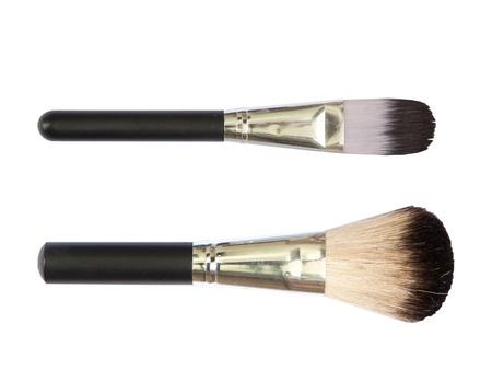 Maquillaje profesional pinceles sobre fondo blanco Foto de archivo