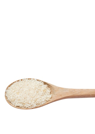 Jasmine rice on wooden scoop isolated