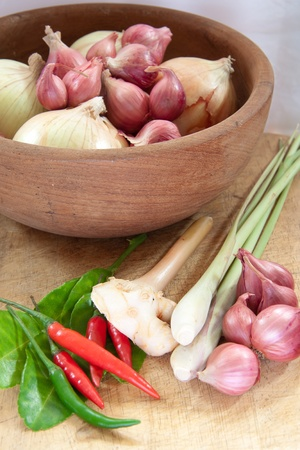 sour grass: asian hot and spicy food ingredient with onions in wooden bowl