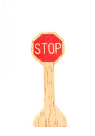 wooden toy made like stop sign on white background photo
