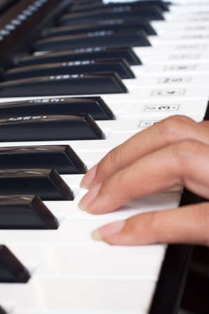 piano keyboard with woman photo