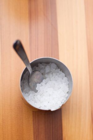 stainless steel bowl of sugar on wood background Stock Photo