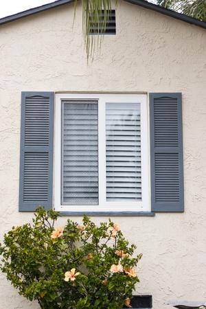 blue tone window in little home photo