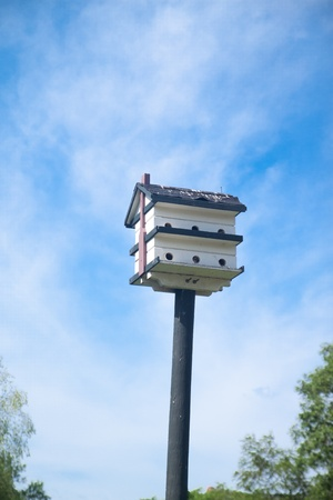 Bird house with blue sky in the cloudy day photo