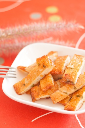 fried fish cakes on white plate on red background Stock Photo