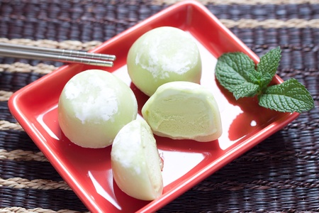 Green tea mochi ice cream on red plate Stock Photo