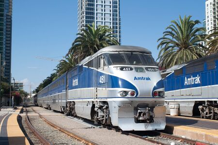 An Amtrak California passenger train leaves the Santa Fe Depot station