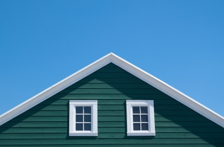 Green house and white roof with blue sky in sunny day photo