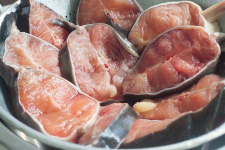 redfish: Fresh raw catfish on sieve prepare for food, close up