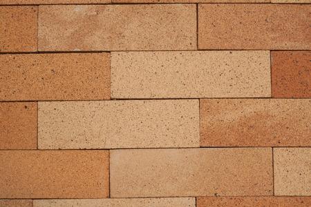 Fondo de la pared de ladrillo, el tono naranja