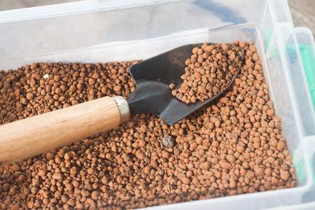 porosity: pumice pebbles in bucket  and gardening tool