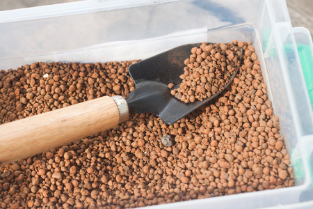 vesicular stone: pumice pebbles in bucket  and gardening tool