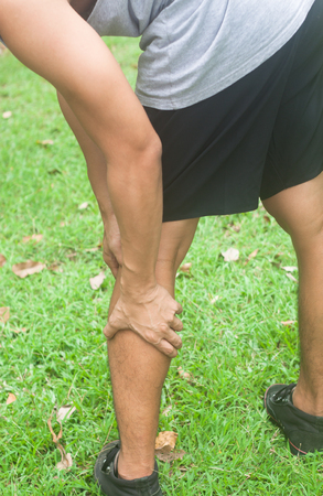 calf pain: Leg calf sport muscle injury. Runner with muscle pain in leg. Stock Photo