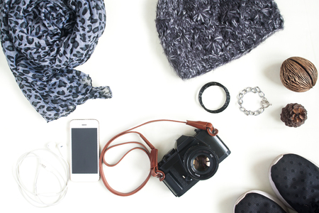 Preparation for travel,trip vacation, tourism mock up of cell phone,camera,scarf,sneaker shoes on white background. Flat lay, top view Stock Photo