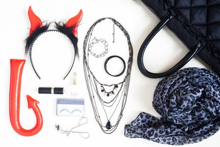 Flat lay photography with Halloween fashion accessories, cosmetics, essential items for woman , Overhead view of Halloween accessories items, top view Stock Photo