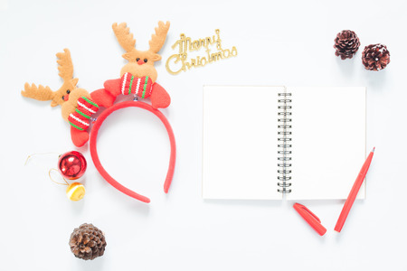 composition notebook: Christmas composition. Christmas decoration, pine cones, notebook and red pen with copy space. Flat lay, top view Stock Photo