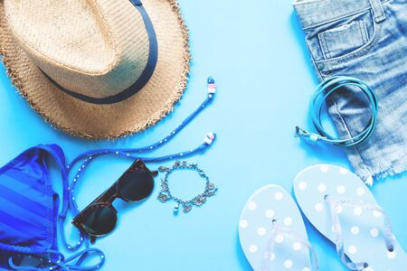 Flat lay of female asccessories on blue background, Spring and summer fashion concept