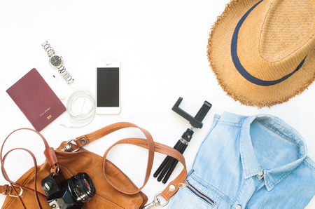 Flat lay of Traveler's items, Essential vacation accessories of young smart woman, Travel concept on white background