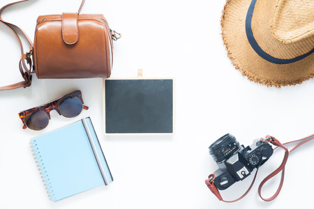 Flat lay style of summer accessories, Travel items on white background with blank board for text