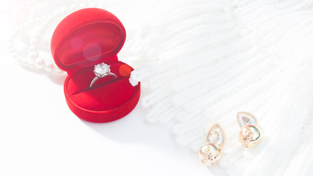 Wedding ring, Diamond ring in red box. Selective focus with copy space