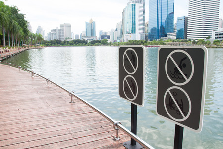 BANGKOK, THAILAND - JUNE 13: Benchakitti Park on June 13, 2017 in Bangkok, The sign rule near the lake with cityscape in the most famous of public park in middle of Bangkok city Stok Fotoğraf - 80585368