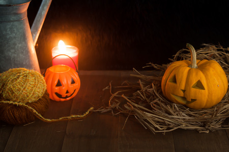 Halloween still life with pumpkins and candle on wooden floor and dark background with copy space Stock Photo