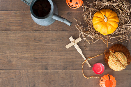 Creative flat lay of halloween still life on wooden background with copy space
