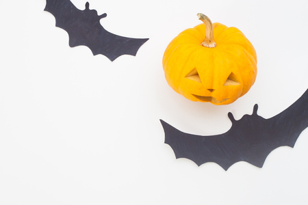 Overhead view of halloween concept with pumpkin and bats on white background Stock Photo