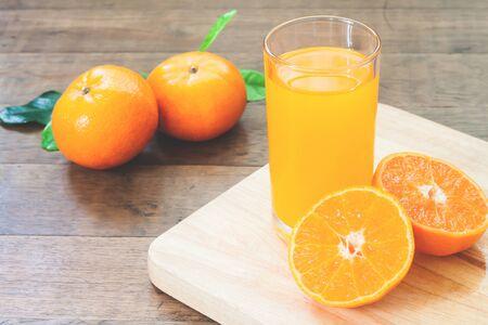 Orange juice with fresh oranges on wood table, Autumn and fall season Stock Photo