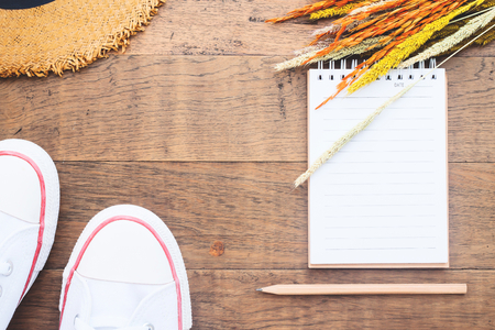 Creative flat lay of blank notebook and pencil on wooden background, Autumn lifestyle