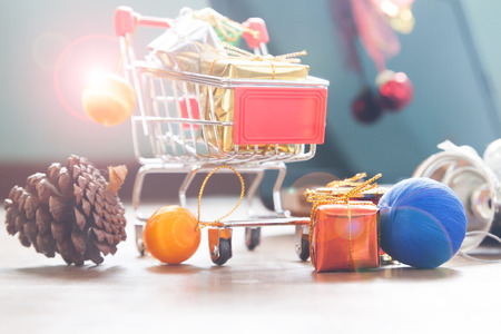 Close up of shopping cart with gift boxes and Christmas decoration Stock Photo