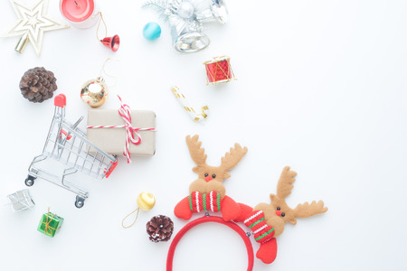 Christmas gift boxes, decorations and shopping cart on white background Stock Photo