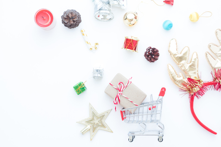 Craft gift box in shopping cart and Christmas gift boxes and decorations on white background Stock Photo