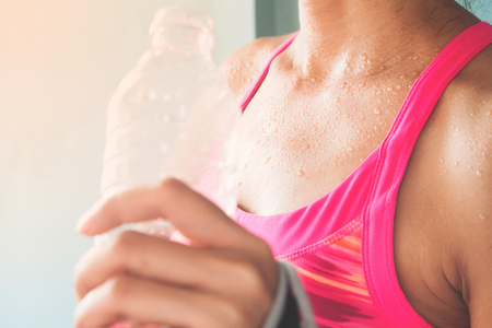 Focus on woman's body with sweat on tanning skin, Healthy lifestyle