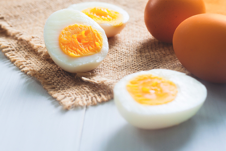 Hard boiled eggs with raw eggs, Nutrition and Healthy food Stock fotó