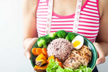 Dieting woman with healthy food. Rice berry with grilled chicken breast and vegetables 版權商用圖片