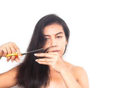 Asian woman with long hair problem on white background with copy space